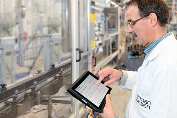 man evaluating control chart on tablet